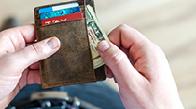Man pulling money out of wallet